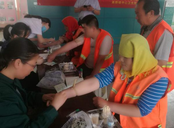 沂水县高桥镇免费健康体检 情暖环卫工人